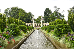 waterway and trees and sphinxes on columns of the Walled Garden at Untermyer Park & Gardens Yonkers, New York