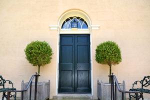entrance with topiary balls at Tudor PlaceHistoric House & Garden in Washington, DC