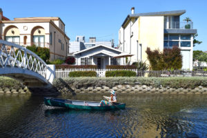 woman in a canoe at California's Venice Canals in Venice, California
