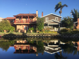 houses reflected in water at California's Venice Canals in Venice, California